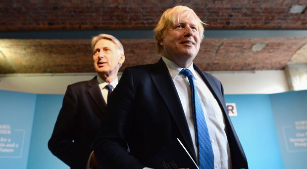 Philip Hammond and Boris Johnson (Stefan Rousseau/PA)