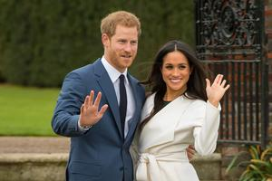Harry and Meghan at a press photocall after announcing their engagement (Dominic Lipinski/PA)