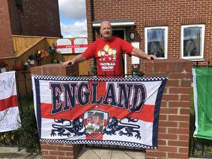 Peter Cowans, 64, with a display of flags outside his home in Ashington (Tom Wilkinson/PA)