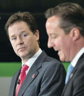 Ministers unveil rail plans...Prime Minister David Cameron and Deputy Prime Minister Nick Clegg give a speech at the Soho Depot in Smethwick. PRESS ASSOCIATION Photo. Picture date: Monday July 16, 2012. A £9.4 billion package of rail projects, including £4.2 billion worth of new schemes, was announced by the Government today. See PA story POLITICS Coalition. Photo credit should read: Tim Ireland/PA Wire...A