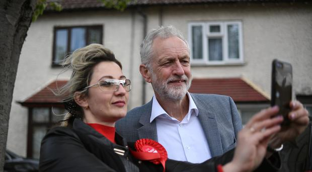 Labour leader Jeremy Corbyn poses for a selfie with Dogsthorpe candidate Katia Yurgutene (Joe Giddens/PA)