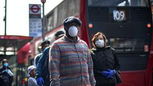 People wearing protective face masks (Victoria Jones/PA)
