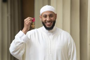 Imam Mohamed Mahmoud said he accepted his OBE on behalf of the community (Victoria Jones/PA)