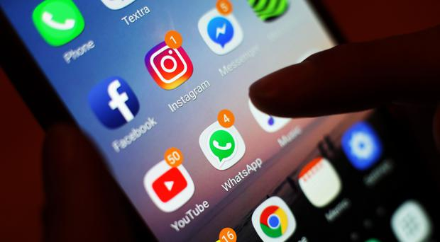 Social media apps displayed on a mobile phone screen (Yui Mok/PA)