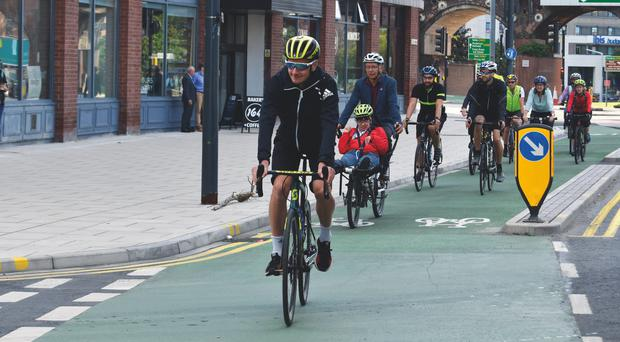 Walking and cycling to work has been linked with fewer heart attacks (Leeds City Council/PA)