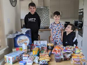 Brothers Joshua Barry, 9, Ben Barry, 7, and Isaac Barry, 4, who are helping deliver food their vulnerable neighbours in Breightmet, Greater Manchester, during lockdown.
