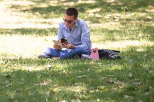 A man reads a book St James Park (Dominic Lipsinki/PA)