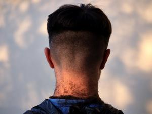 Joshua Chhabra's skin fade, a haircut given to him by his older brother Matthew, taken by commissioned artist Anand Chhabra in Wolverhampton (Anand Chhabra/Historic England/PA)