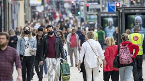 Shoppers wear protective face masks in Edinburgh's Princes Street (Jane Barlow/PA)