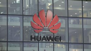 Huawei said it will launch three UK stores (Steve Parsons/PA)