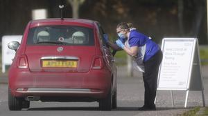 An NHS worker being tested for coronavirus at a temporary drive-thrru testing station in the car park of Chessington World of Adventures in Surrey (Aaron Chown/PA)