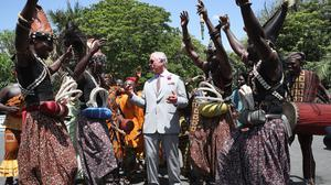 The Prince of Wales is greeted by traditional dancers as he arrives for a visit to Osu Castle in Accra (Chris Jackson/PA)