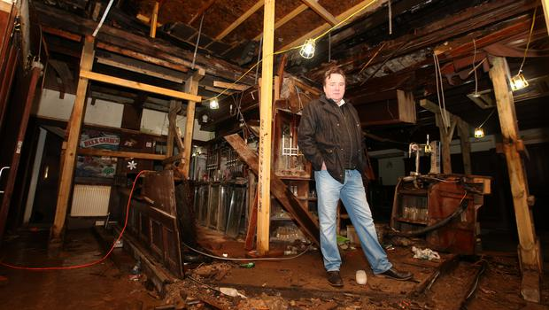 Clutha owner Alan Crossan in the ruins of the bar (Andrew Milligan/PA)