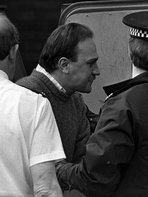 Ian Simms, seen arriving at St Helens Magistrates' Court in 1988, has been in prison for three decades (PA)