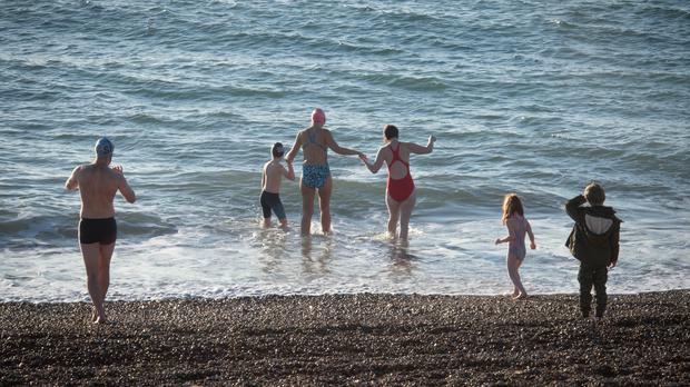 Swimmers near Hythe in Kent (PA)