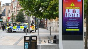 A police car drives through the centre of Leicester, where localised coronavirus lockdown restrictions have been in place since June 29 (Joe Giddens/PA)