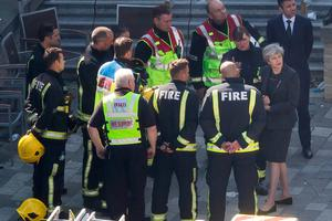 Theresa May talks to emergency personnel