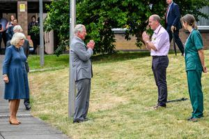 The Prince of Wales remains socially distanced as he a performs a namaste to Professor Mark Pietroni (Ben Birchall/PA)