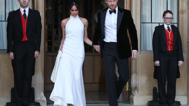 The Duchess of Sussex, who was wearing the Stella McCartney creation, and the Duke of Sussex leaving Windsor Castle for their evening reception (Steve Parsons/PA)