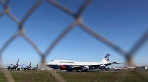 The parent company of British Airways has commenced legal action over quarantine measures which begin on Monday (Andrew Matthews/PA)