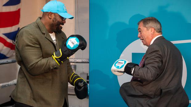 Boxer Dereck Chisora with Nigel Farage during a party rally (PA/Joe Giddens)