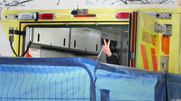 The final anti-HS2 activist gesticulates from the back of an ambulance (Luciana Guerra/PA)