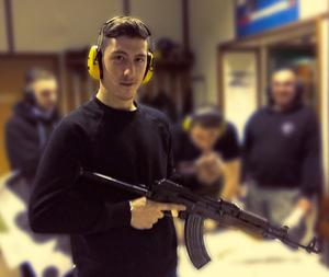 Mark Jones, posing with an AK47. (West Midlands Police/PA)