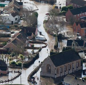 Flooded properties in the village of Moorland on the Somerset Levels