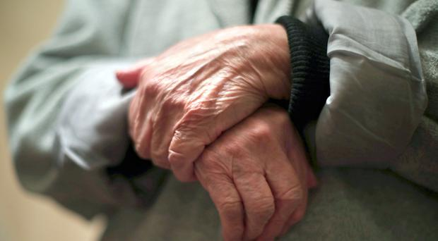 A study found people living with dementia have had to spend almost £15bn of their own money on social care (PA)