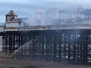 Firefighters working to put out a blaze on Blackpool Pier (Lancashire Fire and Rescue Service/PA)