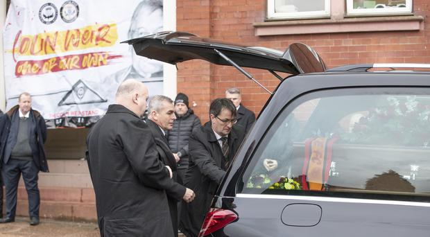 Partick Thistle chief executive Gerry Britton places a wreath on the coffin outside Firhill stadium (Jane Barlow/PA)