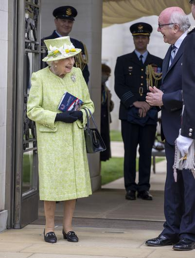 The Queen is greeted by Australia's High Commissioner George Brandis before the service. (Steve Reigate/Daily Express/PA)