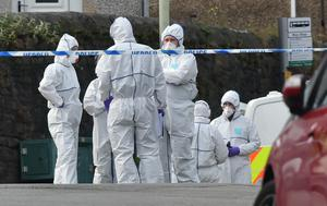Forensic officers at the scene (Ben Birchall/PA)