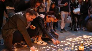 Mourners view tributes in St Ann's Square, Manchester (PA)
