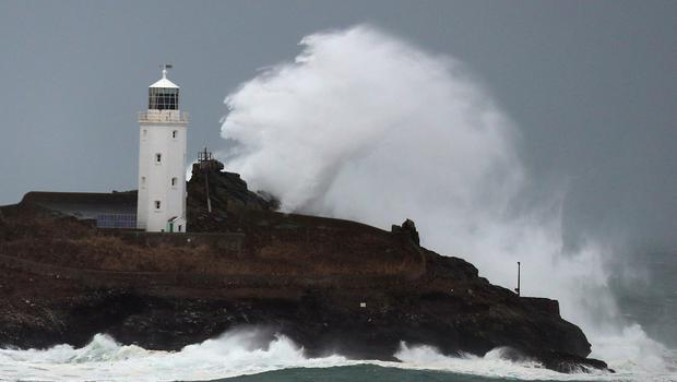 Waves crash against Godrevy Lighthouse in the constituency of St Ives (Steve Parsons/PA)