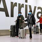 Passengers in the arrivals concourse at Heathrow Terminal 4, London )Steve Parsons/PA)