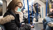 A woman wearing a facemask on the London Underground (Ian Hinchliffe/PA)