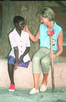 Diana with Sandra Tigica, 13, at the orthopaedic workshop in Neves Mendinha, near Launda, Angola, during her visit in 1997 (John Stillwell/PA)