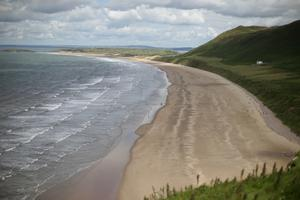 People will be able to visit beaches such as Rhossili Bay in Swansea (Yui Mok/PA)