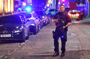 Armed police are on Borough High Street after an incident around London Bridge (Dominic Lipinski/PA)