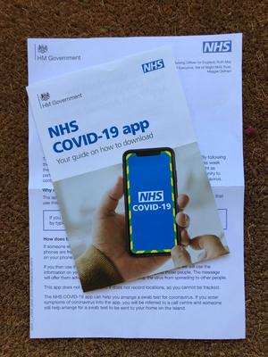 The leaflet and information pack explaining the Government's NHS Covid-19 contact tracing app (Andrew Nordbruch/PA)