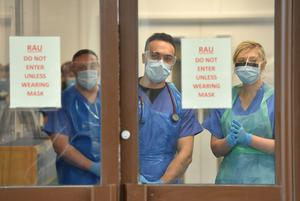 Medical staff wearing personal protective equipment await patients admitted to the ICU (Jacob King/PA)