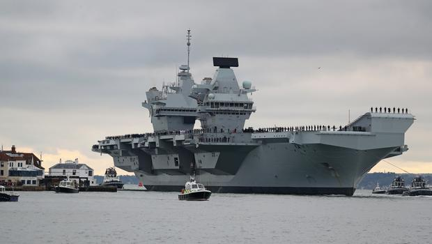 The aircraft carrier HMS Prince of Wales arrives at Portsmouth Naval Base (Steve Parsons/PA)
