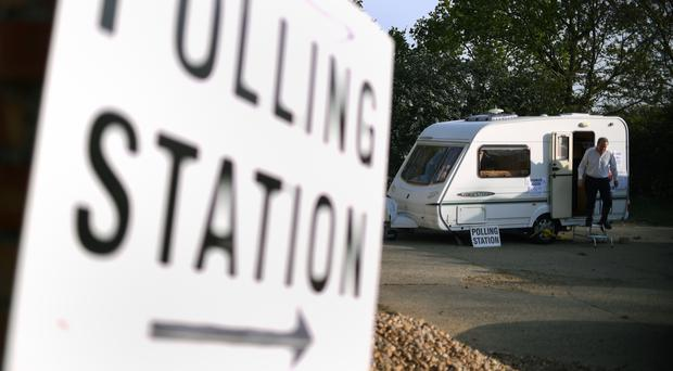 A man leaves after casting his vote in a caravan (Joe Giddens/PA)