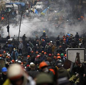 Anti-government protesters crowd the Independence Square in Kiev, Ukraine (AP)