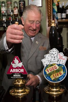 The Prince of Wales pours a pint (Aaron Chown/PA)