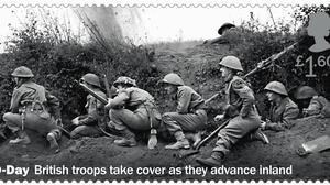 One of the stamps issued to mark D-Day anniversary shows troops taking cover as a shell explodes nearby (Royal Mail/PA)