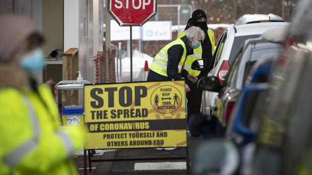 Members of the vaccination team working at the drive-through Covid-19 vaccination centre in Edinburgh (Jane Barlow/PA)