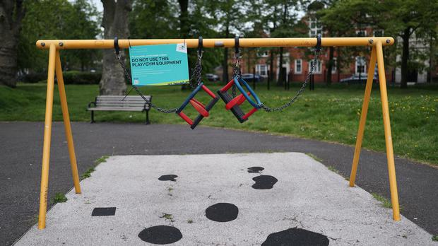 Activity equipment in the children's playground area of a park in London is closed off (PA)