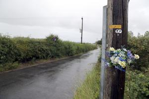 Tributes left in Ufton Lane near Sulhamstead, Berkshire, where PC Andrew Harper died in August 2019. (Steve Parsons/PA)